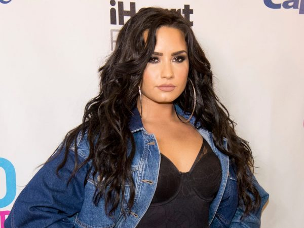 Demi Lovato throws breat at the strip club.